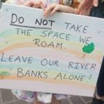 """Young protesters sign """"Leave our River Banks Alone!"""""""